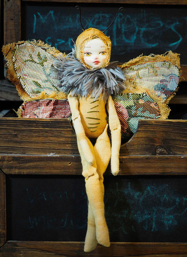 A beautiful original Danita Art Moth or Night Butterfly Art Doll, carefully crafted and handmade soft sculpture to use as autumn vintage home decor.