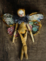 A beautiful original Danita Art Moth or Night Butterfly with fabric wings art doll, carefully crafted and handmade soft sculpture to use as autumn vintage home decor.