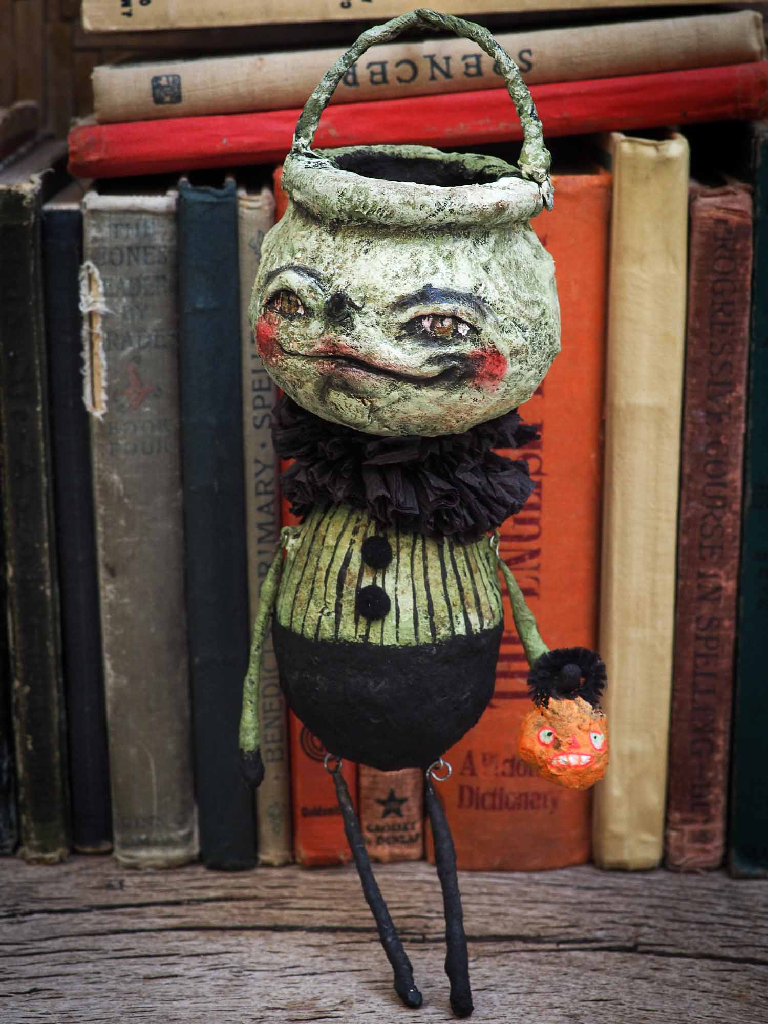 Handmade Halloween ornament posable doll by Danita. It is handmade using spun cotton and paper clay to make a whimsical Halloween home decor decoration