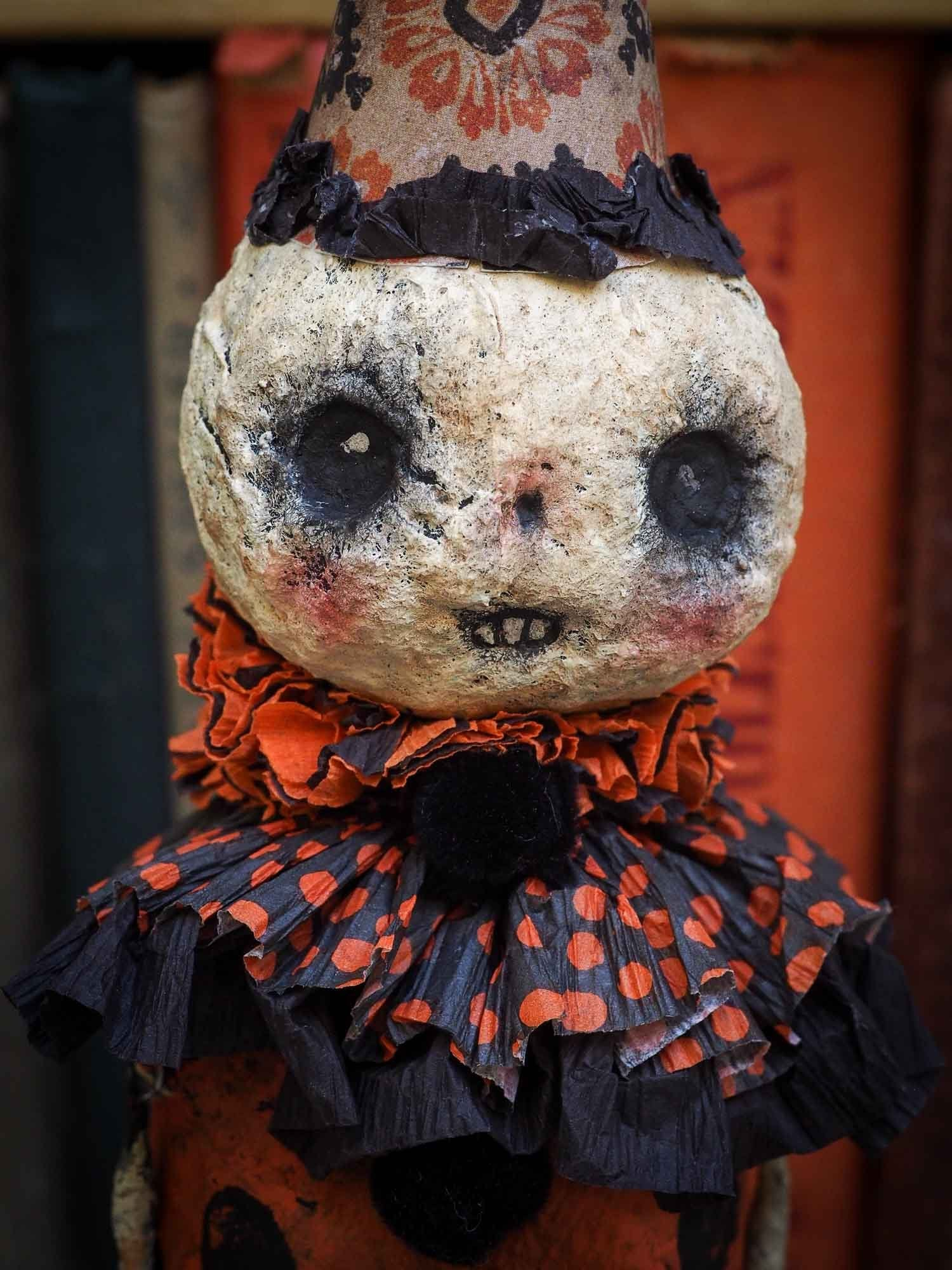 A Halloween carol is Danita's version of the tale of the three ghosts in A Christmas carol. Danita made handmade art dolls in spun cotton using ghouls, jack-o-lanterns, skeleton, witches, ghosts and more to create a visually inspiring set collection of Handmade dolls to create a beautiful Halloween story and home decor decoration.