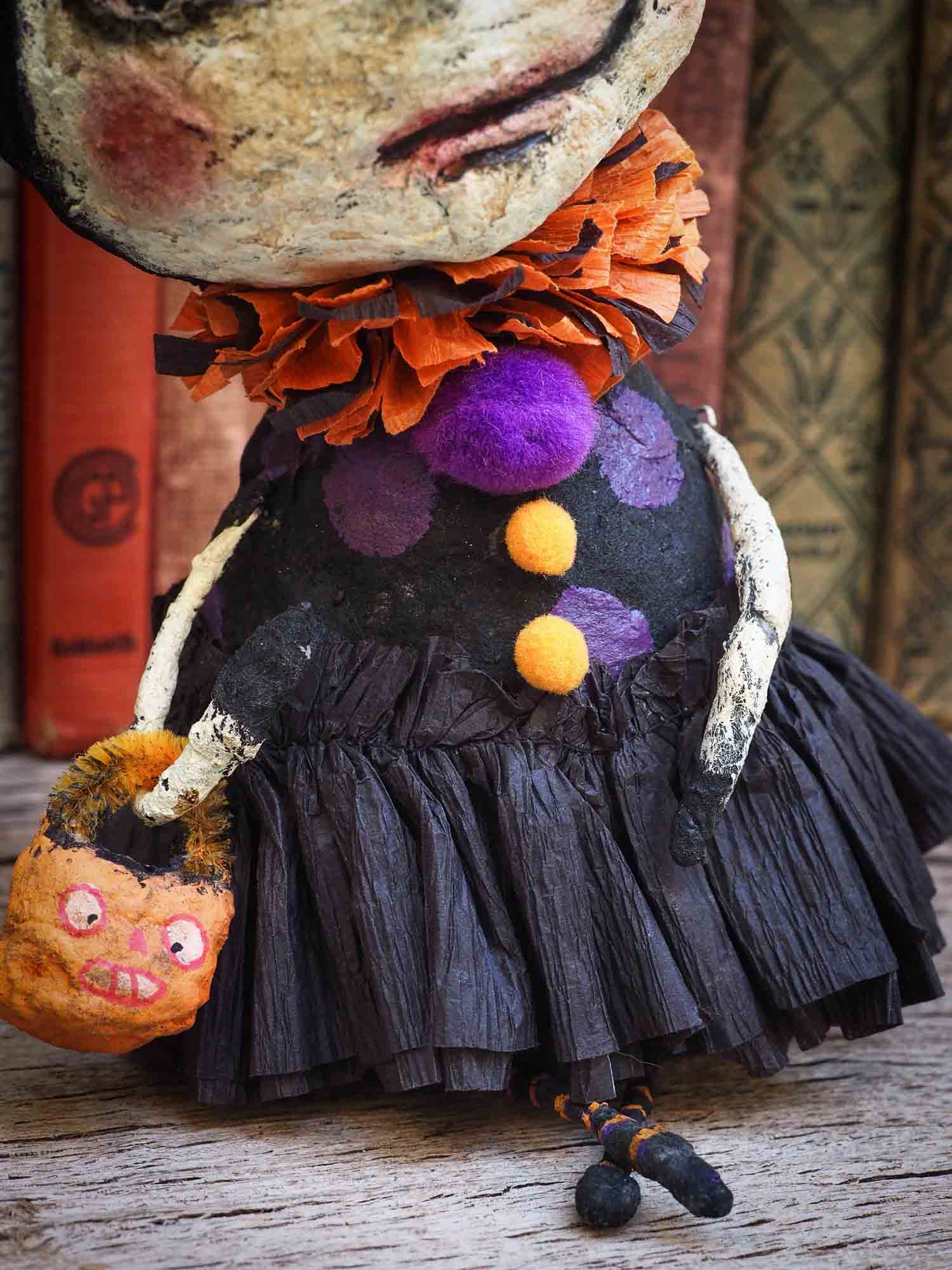Danita original handmade Halloween art. Hand Made ornament for Halloween it is a witch cauldron made of paper clay and spun cotton to hang as as home decor decoration for a Halloween or Christmas tree.