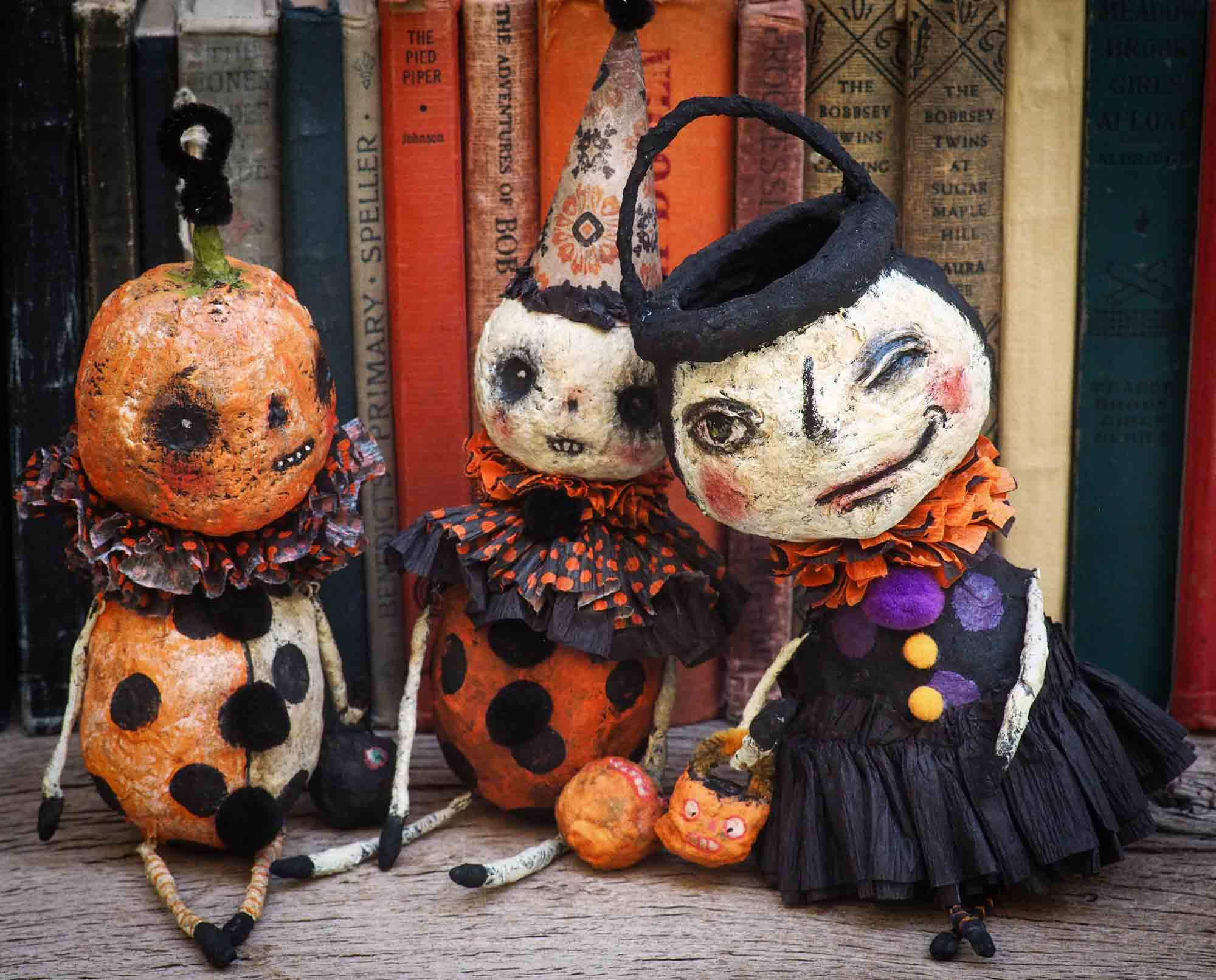 Danita Art thought about the Christmas carol story and decided to make a Halloween version with ghosts, ghouls, pumpkins, jack-o-lanterns, witches, cauldrons and more night creatures. This handmade art doll ornament for Christmas or Halloween trees is made with Spun cotton and paper clay,