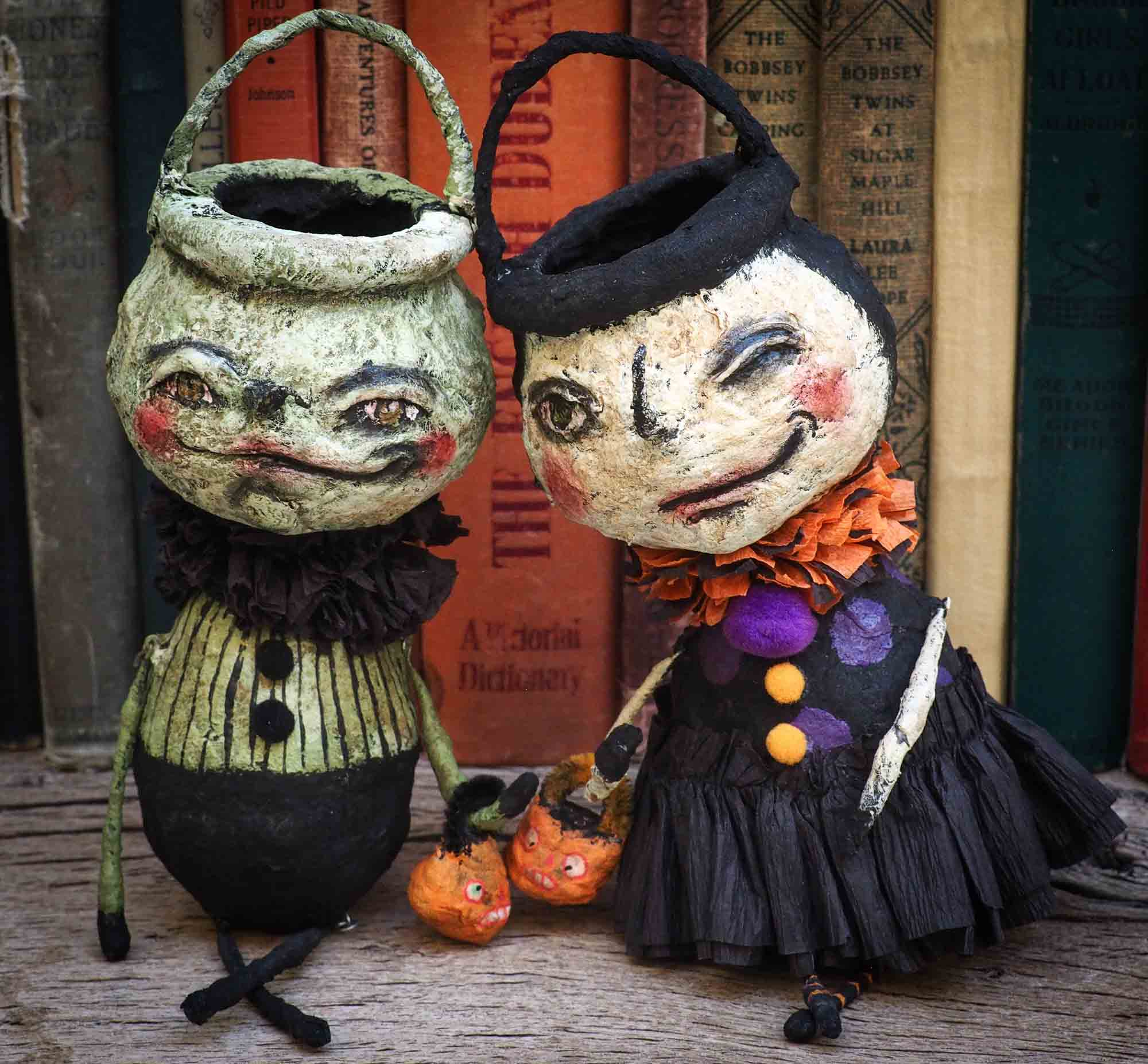 A collection of Danita original handmade Halloween art doll figures and toys. The jack-o-lanterns, pumpkins, witches, ghosts, ghouls and night creatures. They can be used as shelf home decor decoration or ornaments to hang on a Halloween or Christmas tree.