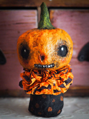 Original Danita Art Kokeshi Art doll for Halloween. An orange pumpkin made with organic 100% natural spun cotton, hand sculpted and painted by Danita. This hand made doll is perfect for Halloween decorations!