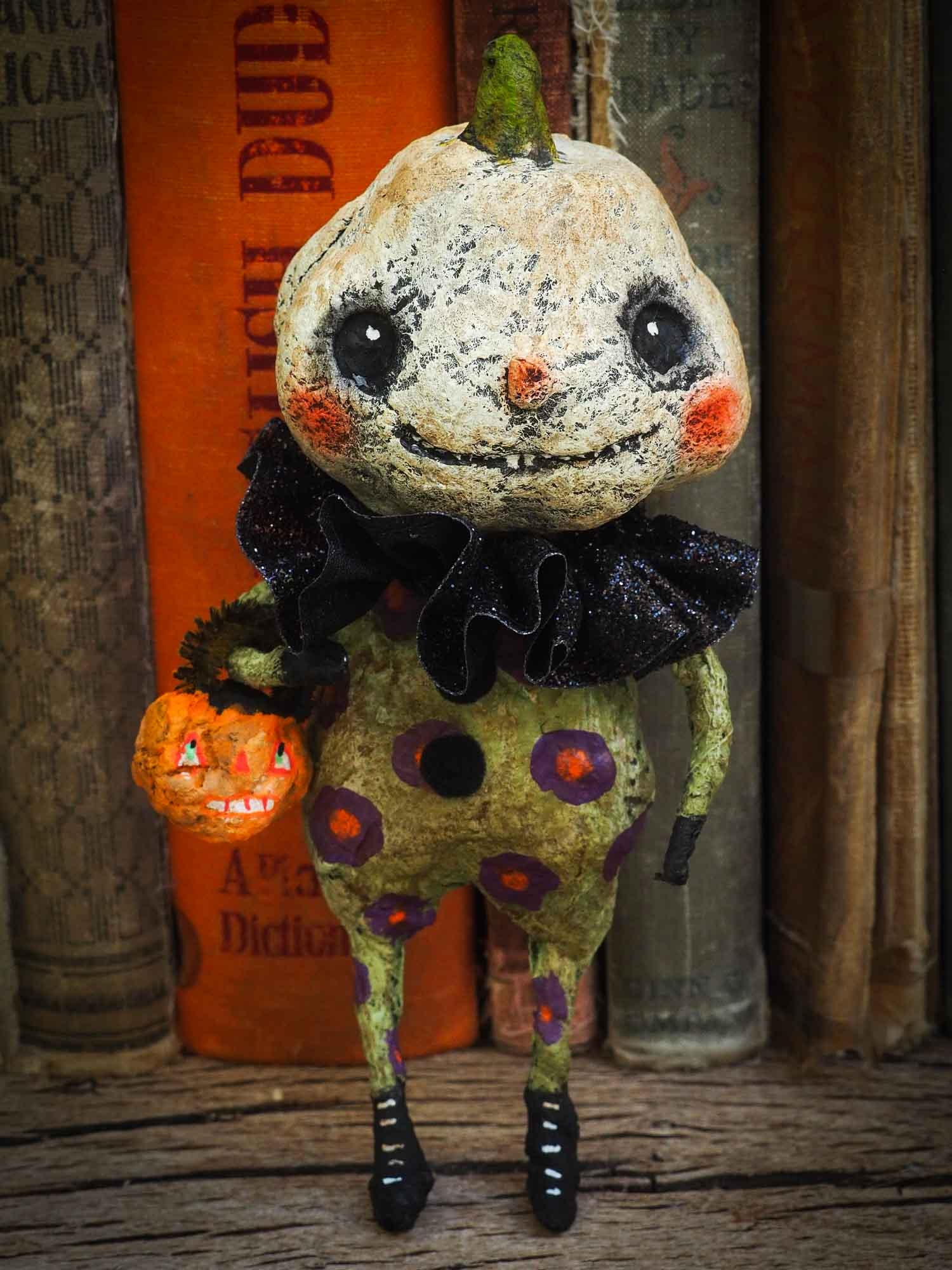 pumpkin jack-o-lantern ornament Halloween decoration. Danita art original handmade art doll pumpkin made with spun cotton from collection of witches, ghosts, skeletons, jack-o-lantern, pumpkin, vampire, ghouls and other whimsical folk art style home decor.