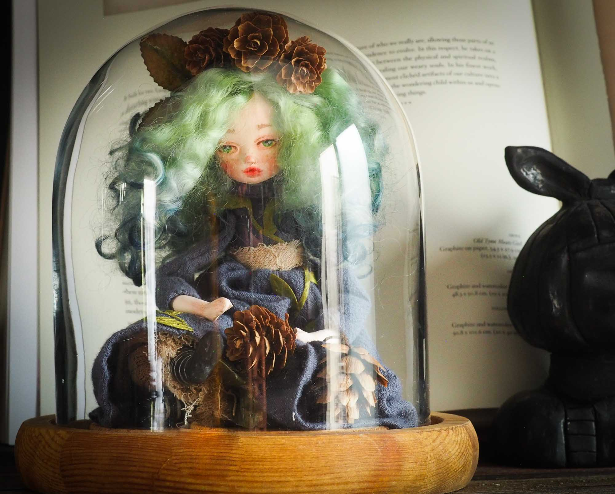 Original Danita Art handamde doll. Gaia mother nature is represented on this handmade figurine with pine cones, leaves and amazing details on her face and eyes. It is a perfect fantasy figurine gift.