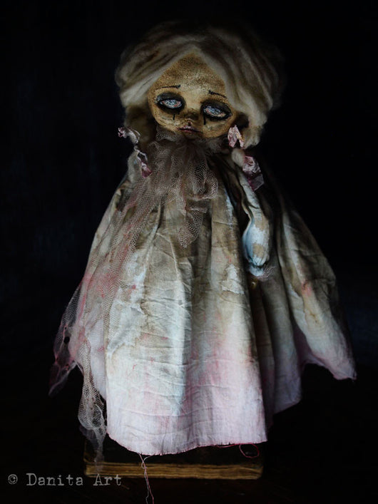 A beautifully detailed horror handmade art doll by Danita Art