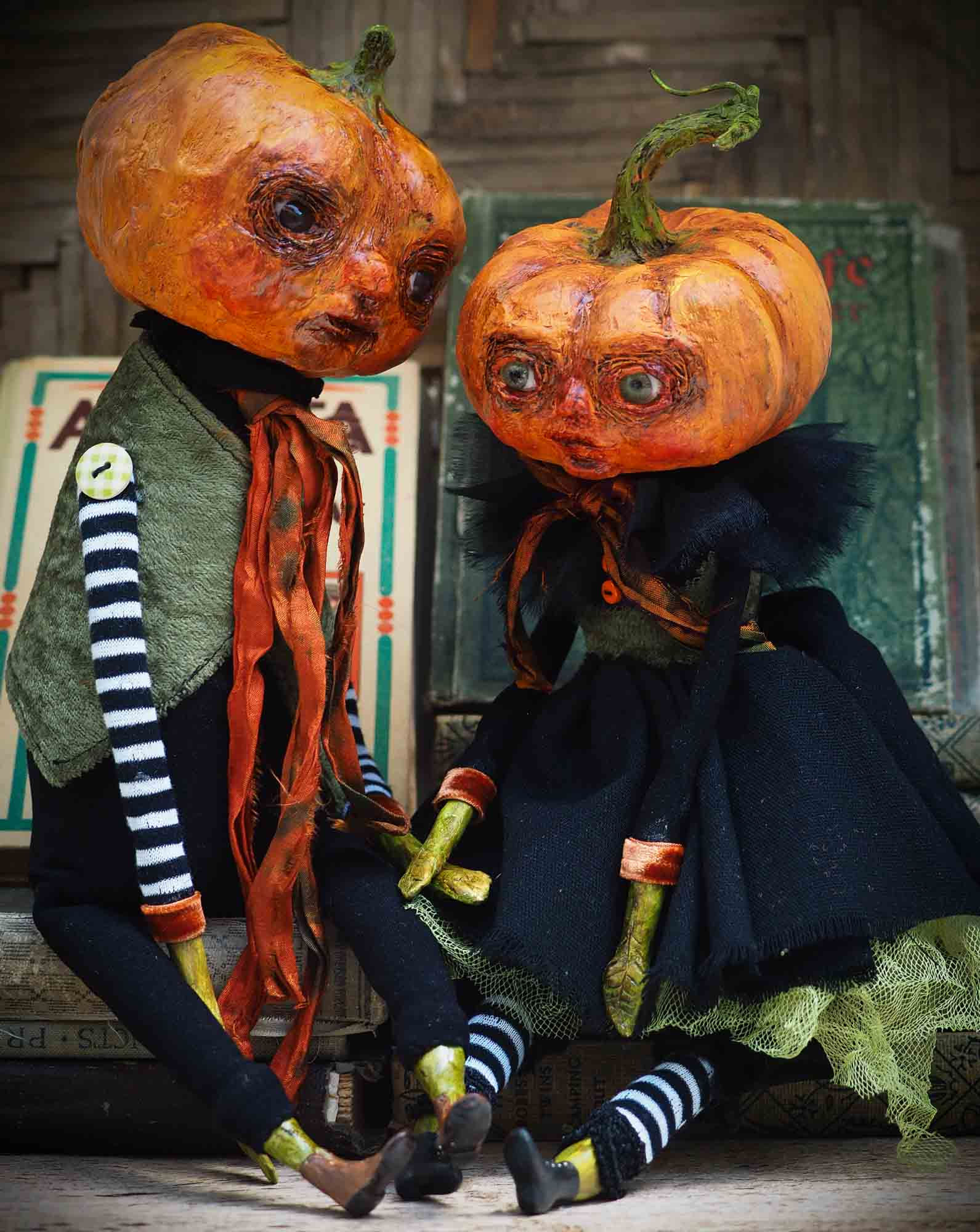 A witch transformed a girl into a Halloween pumpkin monster. This Danita original doll is a handmade jack-o-lantern soft sculpture as home decoration ornament. Carefully handmade with whimsical folk art roots, the spooky ghosts, witches, vampires, ghouls, and jack-o-lantern doll toys of Danita are full of mystery lore.