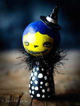 A whimsical wicked witch of the west wooden kokeshi art doll made by Danita Art