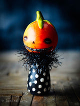 A whimsical wicked jack-o-lantern Halloween pumpkin wooden kokeshi art doll made by Danita Art