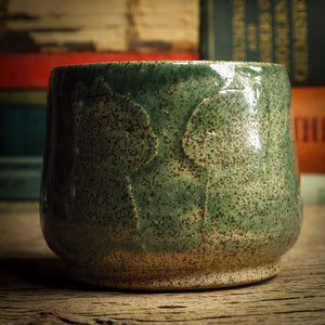 An original glazed ceramic jar by Idania Salcido, the artist behind Danita Art. It measures 3 x 3 x 3 Inches, with deep green hue glazes and hand decorated figures on the sides. Totally handmade in my studio, this is a unique piece that cannot be repeated. Food and drink safe, hand wash only.