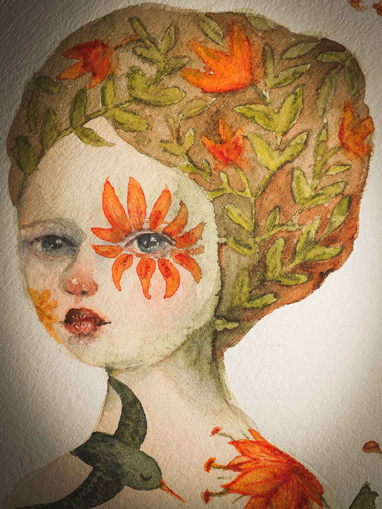 This original Idania Salcido (Danita Art) painting was made on a circular 12 x 12 Inch handmade watercolor paper, depicting a beautiful woman representing mother nature, with a wreath around it, orange flowers in her hair, a flower around her eye and a flying green bird at her shoulder.
