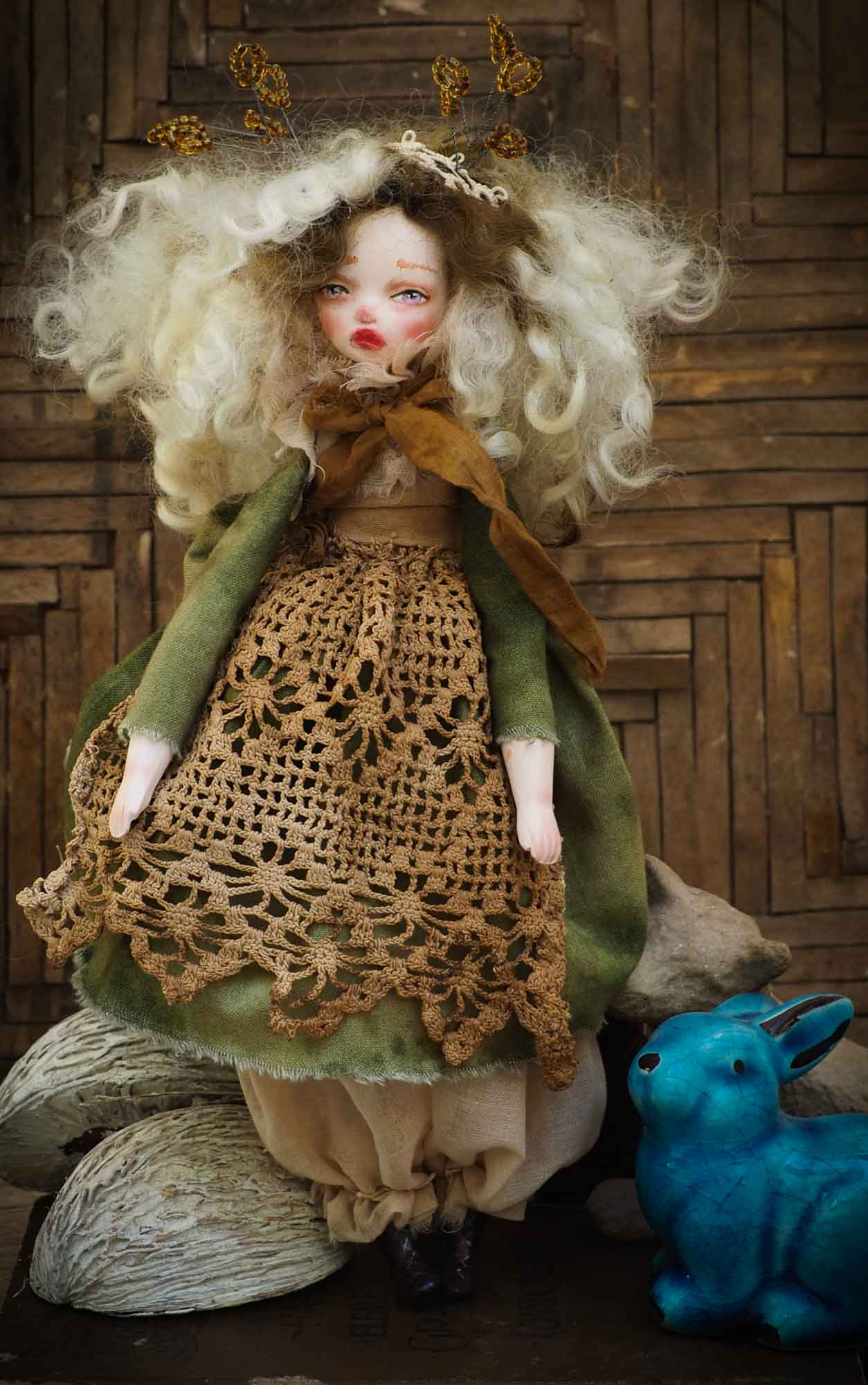 An original Danita handmade art doll, inspired by the sounds and smells of the Autumn forest, dry leaves and the colorful scenery of Mother Nature.  Her name is TERRA, goddess of the earth and home to all of us. She is dressed in a beautiful hand made green dress and a brown lace apron that represent the life giving power of earth and plants.