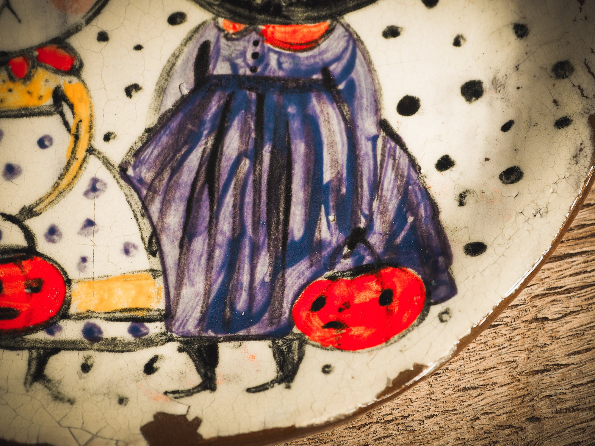 An original handmade Halloween ceramic dinner plate by Idania Salcido, Danita Art. Each plate is hand painted and glazed with pumpkins, witches, cats, jack-o-lanterns and moons. Made with fired glazed ceramics, this little witch, jack-o-lantern and cat plate is painted with delicate patterns that make it one of a kind artwork.