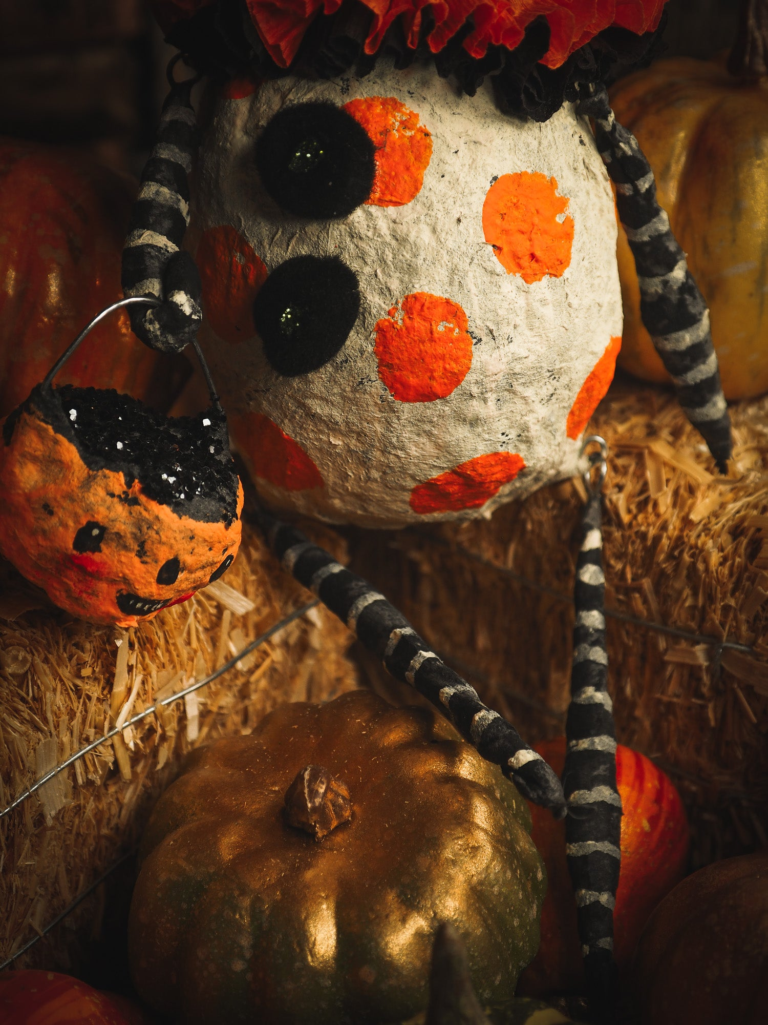 This adorable Halloween handmade ornament pumpkin jack-o-lantern doll monster by Idania Salcido, the artist behind Danita Art, is made with painted spun cotton and paper. It has hand painted face, teeth and eyes with a glittery paper had and matching paper costume. A Halloween home decoration on trick-or-treat night.
