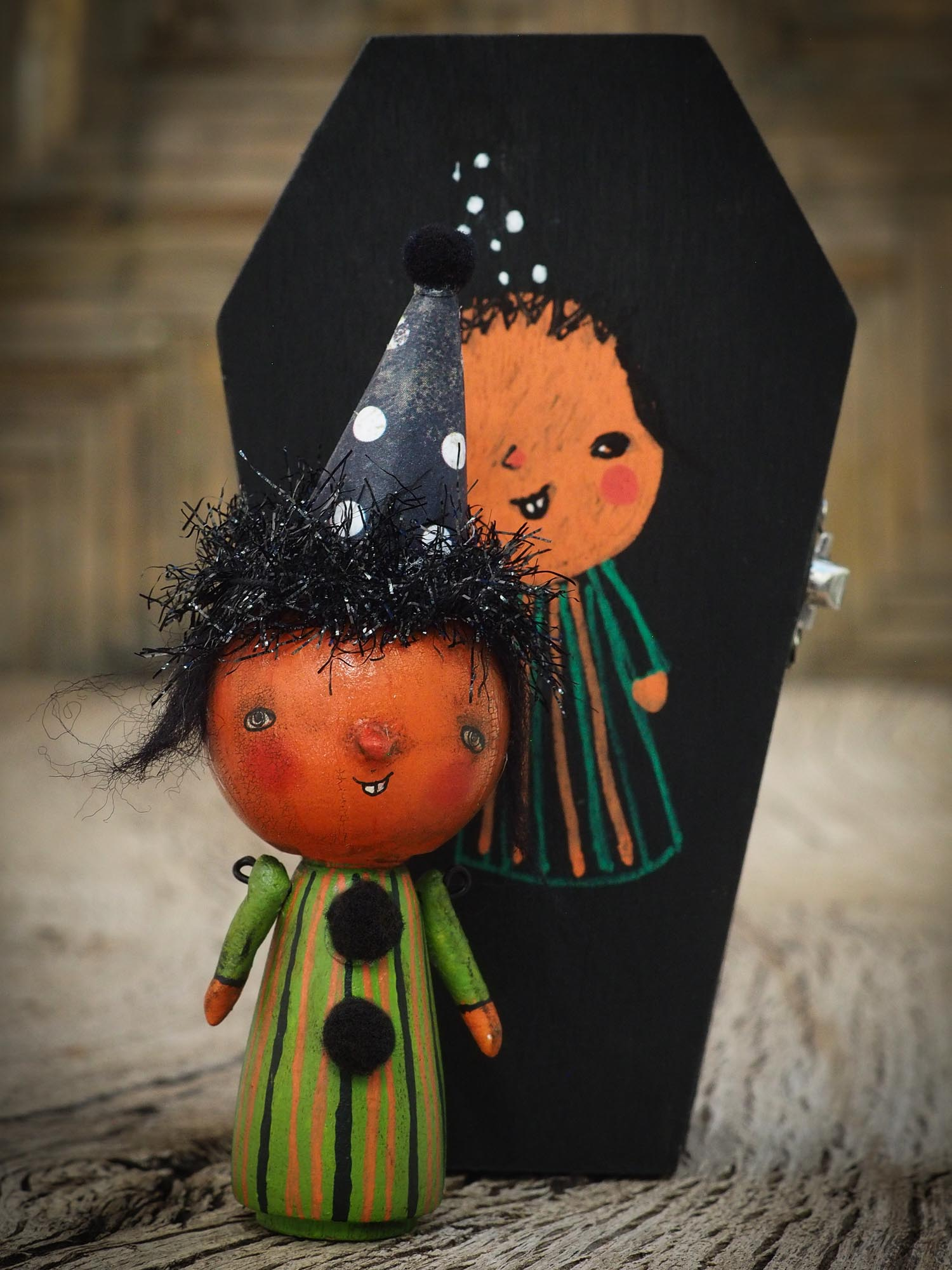 Folk art whimsical halloween witch mini kokeshi wooden style art dolls, designed and hand painted by non other that Danita Art, with painted body and wizard and witch clothes, adorable hand sculpted noses and a beautiful face with a whimsical smile. They come with a coffin shaped display and storage case for home decor