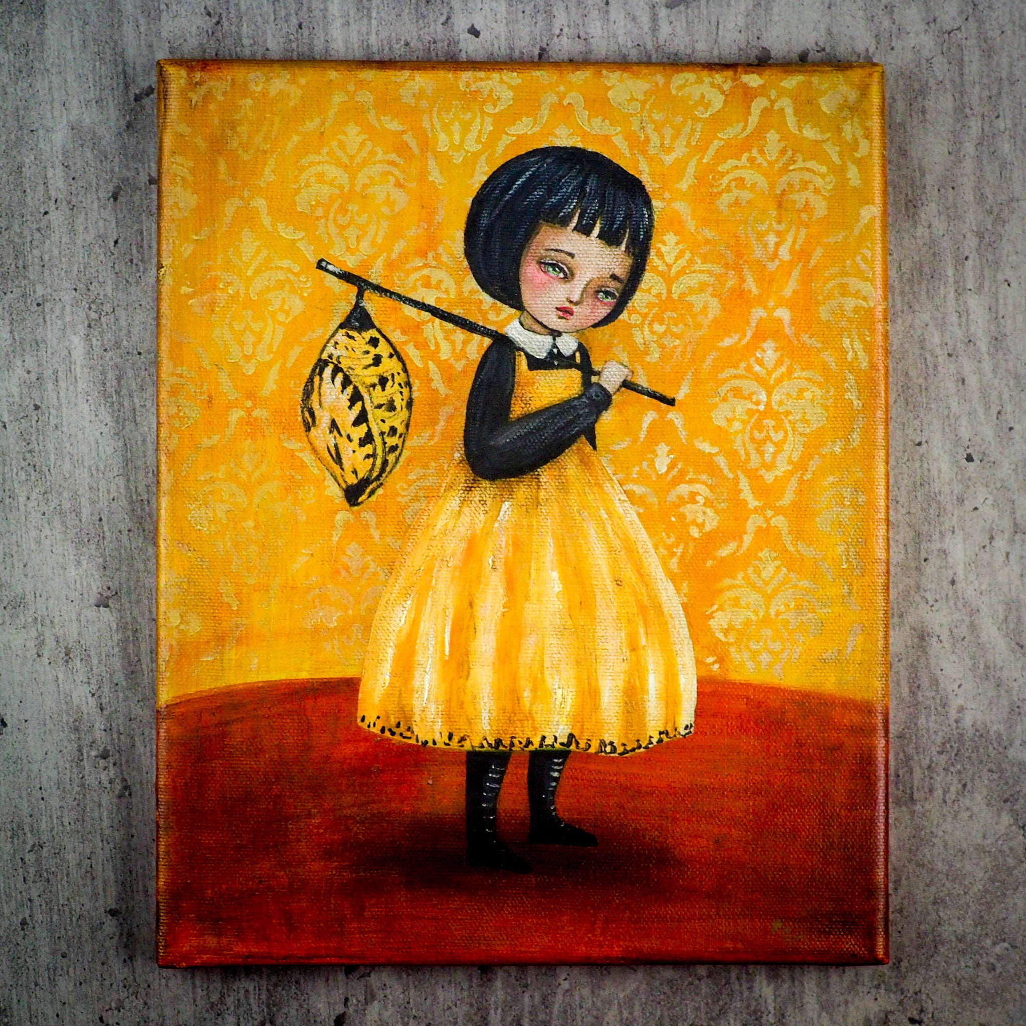 Yellow butterfly girl carries chrysalis on painting by Danita. Surrealist image of girl with Folk Art primitive influences.