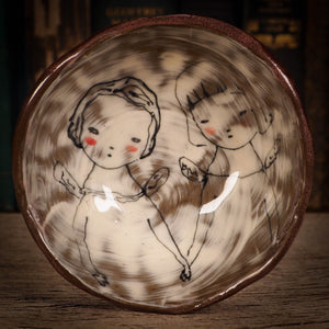 An original glazed ceramic food bowl by Idania Salcido, the artist behind Danita Art. Totally handmade in my studio, this is a unique piece that cannot be repeated. Food and drink safe, hand wash only. Brown earth tones and an ink drawing of two angel girls on the outside.