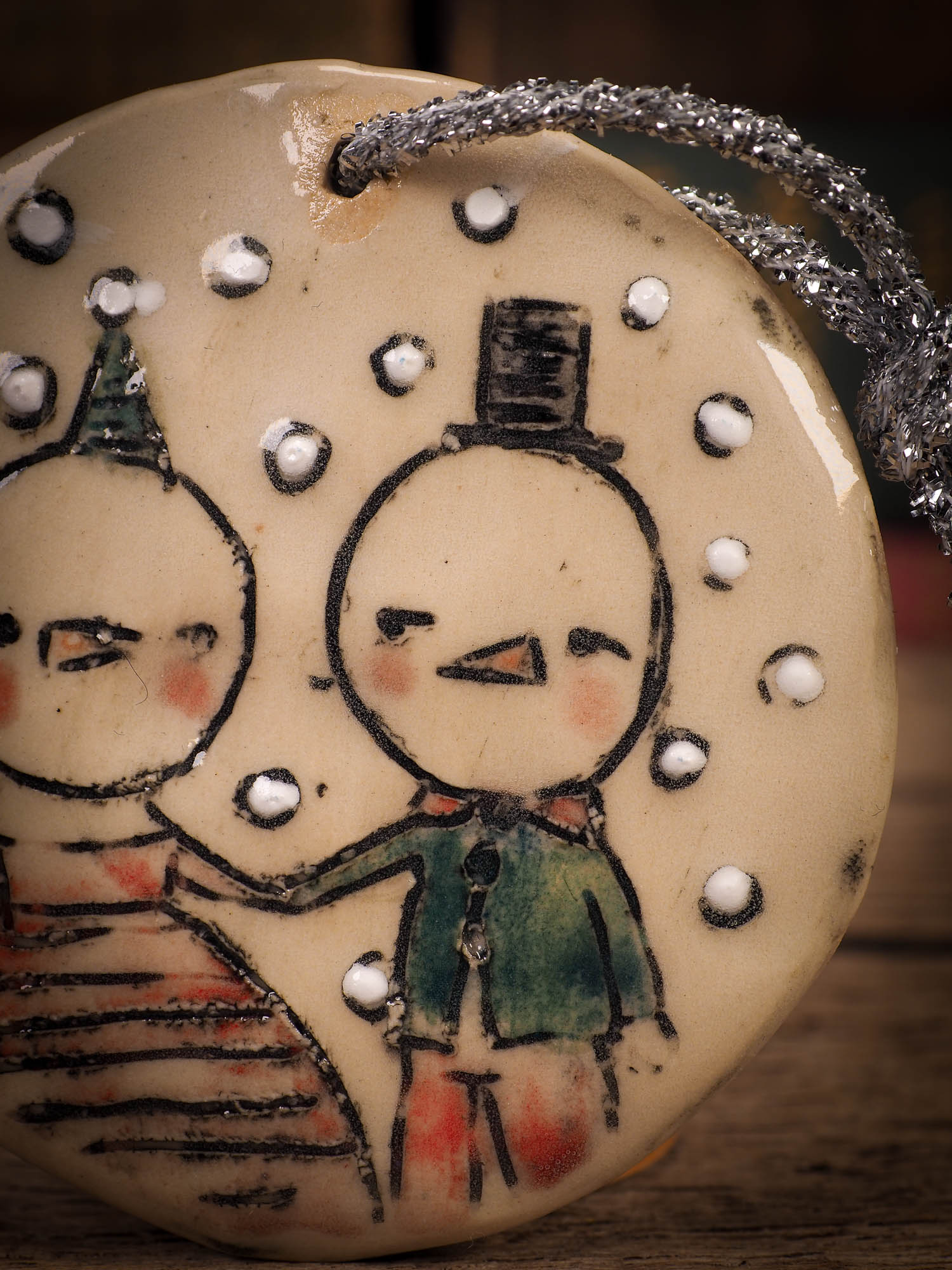 An original Christmas Holiday tree round glazed ceramic ornament handmade by Idania Salcido, the artist behind Danita Art. Glazed carved sgraffito stoneware, hand painted and decorated, it is illustrated by hand with winter scenes with snowmen, Christmas trees, Santa Claus, snow balls and winter themes.
