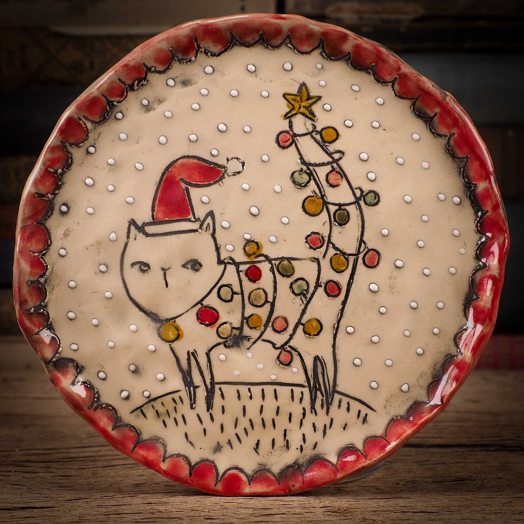 An original Christmas Holiday cake dinner dessert plate round glazed ceramic dinnerware handmade by Idania Salcido, the artist behind Danita Art. Glazed carved sgraffito stoneware, hand painted and decorated, it is illustrated by hand with snowmen, Christmas trees, Santa Claus, angels and snow balls and winter themes.