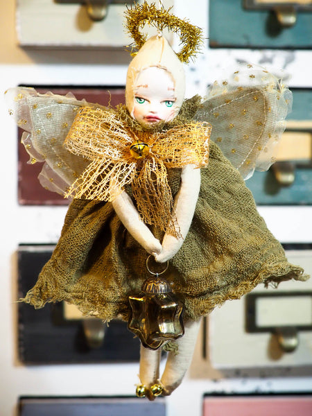 ou are looking at an original handmade Christmas tree ornament by Danita Art.  This beautiful holiday angel is completely hand crafted by Danita in her studio, using sculpted faces she paints by hand, giving each doll a unique personality.  The dress in this doll is hand dyed using natural pigments that Danita extracts from flowers, fruits and seeds, and they have a very organic and natural aged and distressed look.