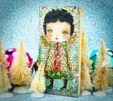 A mica covered holiday angel mixed media painting created by the fantastical hands of Danita Art