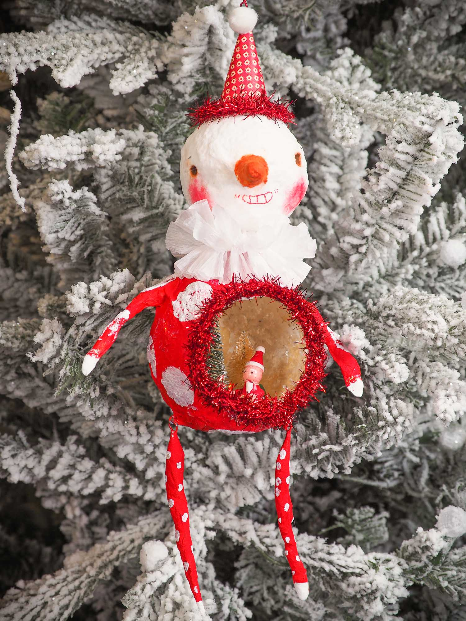 Adorable handmade spun cotton Art Doll Christmas tree ornament by Idania Salcido, the artist by Danita Art. Hand painted by the artist holiday figurine with paper hat with tinsel and vintage style garlands and a tiny Christmas tree. Hang this handmade ornament from your Christmas tree or use as Holiday decoration.