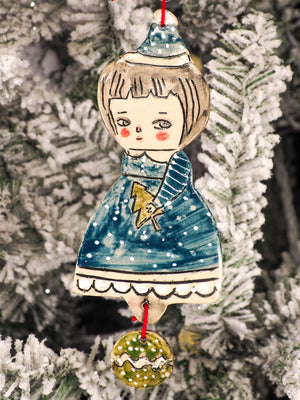An original Christmas Holiday tree round glazed ceramic ornament handmade by Idania Salcido, the artist behind Danita Art. Glazed carved sgraffito stoneware, hand painted and decorated, it is illustrated by hand with snowmen, Christmas trees, Santa Claus, angels and snow balls and winter themes.