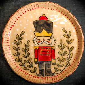 An original Christmas Holiday cake dinner dessert plate round glazed ceramic dinnerware handmade by Idania Salcido, the artist behind Danita Art. Glazed carved sgraffito stoneware, hand painted and decorated, it is illustrated by hand with snowmen, Christmas trees, Santa Claus, angels and snowballs and winter themes.
