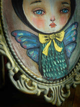 The boy with butterfly wings has beautiful wings painted in iridescent colors. Original by Danita Art.