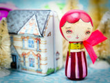 Danita's winter Kokeshi dolls come with a tin house to store them