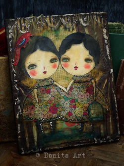 Inspired by her fascination with twins, Danita created a mesmerizing couple of girls with floral dresses on this original encaustic mixed media encaustic collage painting.
