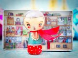 The tin houses on Danita's Kokeshi wooden dolls can be used to display or store them
