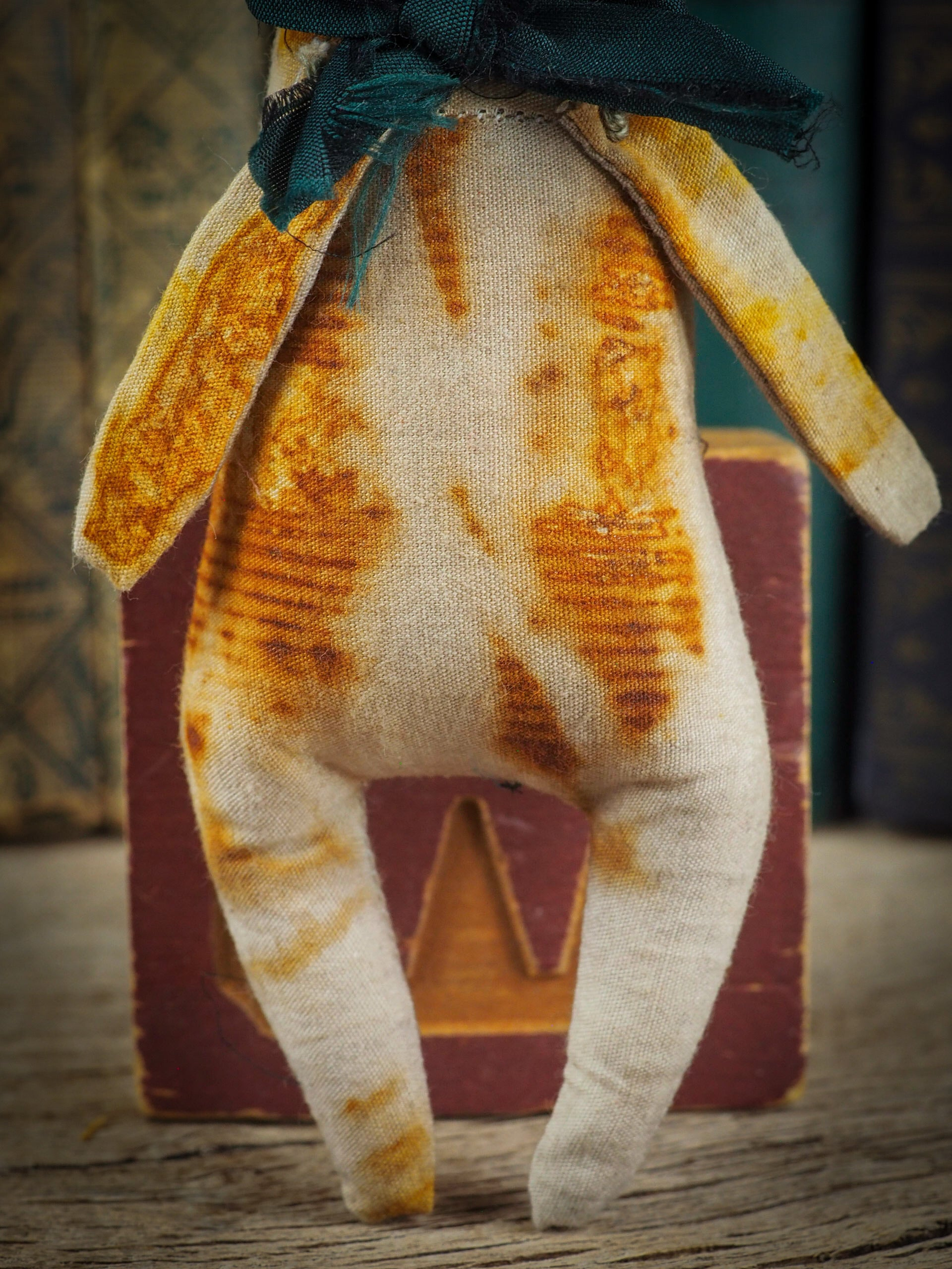 Soft sculpture art doll by Idania Salcido Danita Art with a Handmade ceramics face, organic dyed fabric and silk bow