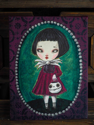 Original painting by Danita, a vampire undead zombie ghoul girl with Halloween with a skull pumpkin jack-o-lantern in her arms. Whimsical and surreal art perfect as home decor this Halloween Night.