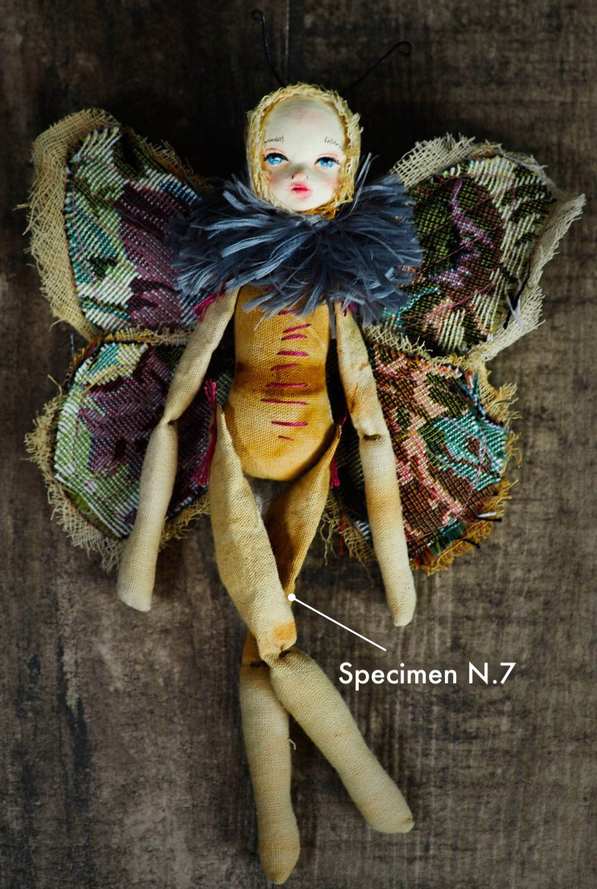 Inspired by nature, Danita created a handmade art doll moth, or night butterfly using organic materials like vintage and hand dyed fabric, wire and clay on a melancholic articulated soft sculpture. An art doll toy that celebrates nature's creations and the beautiful wings of insects with a bit of magic fairy on them.