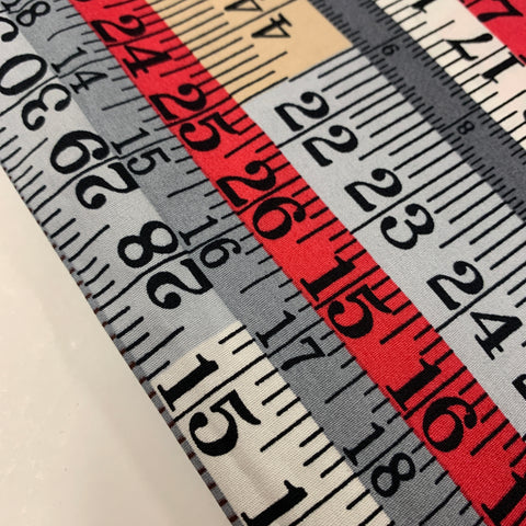 1.5m LEFT: Kitsch cotton poplin fabric with tape measure pattern