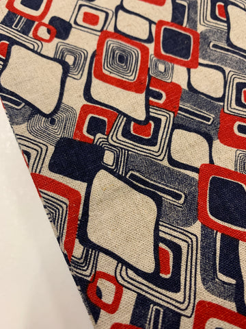 1/2m LEFT: Modern linen cotton with abstract pattern in navy and red