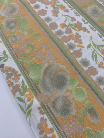 1m LEFT: 1970s light weight cotton crepe with orange & green floral on white