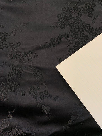 1m LEFT: Luxe black on black Oriental woven silk brocade blossom
