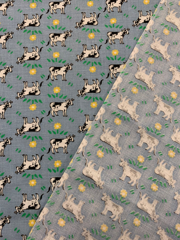1.5m LEFT: Modern quilt cotton with small cows & tiny yellow flowers on blue