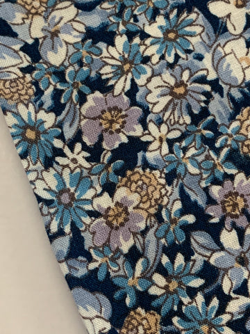 1m LEFT: Vintage 1970s slightly floppy cotton with dark blue base & floral