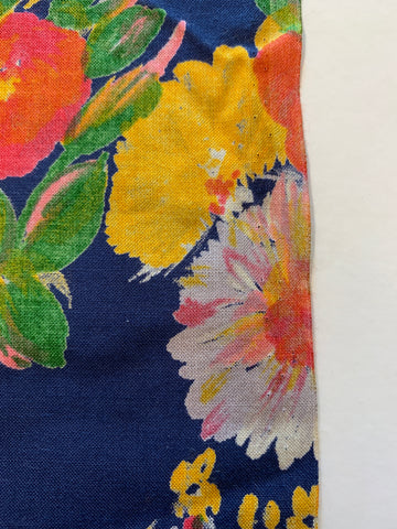 1/2m LEFT: Lovely bright painterly floral on deep ocean blue base rayon