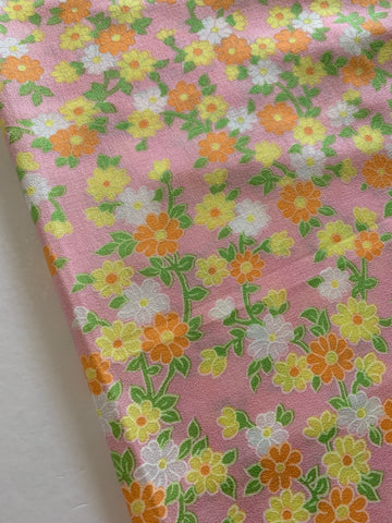1/2m LEFT: Vintage 1960s bright orange pansy on lolly pink cotton