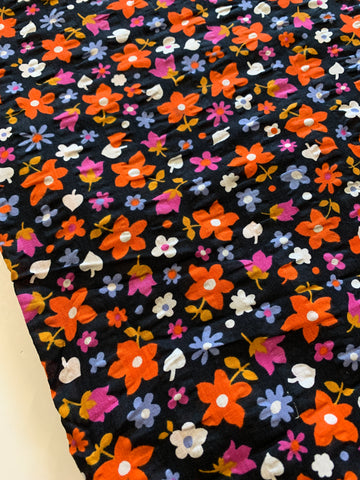3m LEFT: Vintage retro 1970s bright flowers on black cotton seersucker