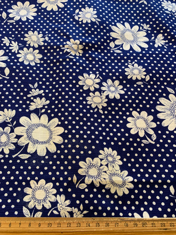 1/2m LEFT: Linen look 1960s cotton with mod floral & spots on navy blue