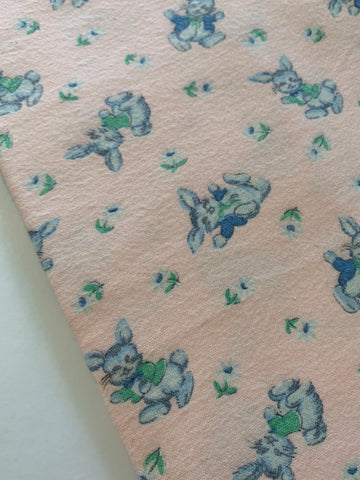 LESS THAN 3m LEFT: Vintage 1960s pink flannelette w/ blue bunnies hopping about