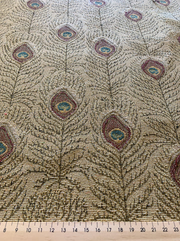 LESS THAN 1m LEFT: Lovely red green peacock feathers pale camel base upholstery fabric