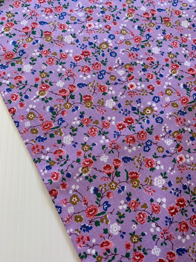 1/2m LEFT: Modern quilt cotton with orchid purple base and small bright floral