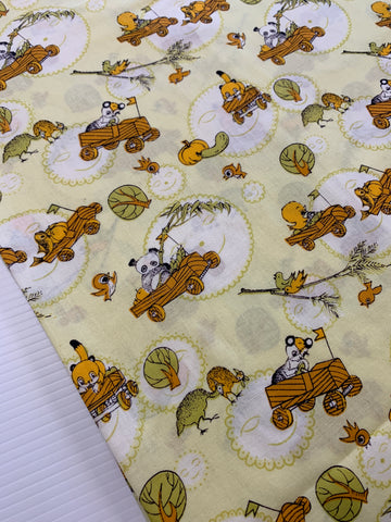1m LEFT: Vintage 1970s novelty kiddies cotton w/ animals cavorting yellow base